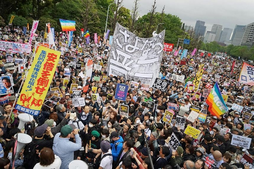 Demonstrators protesting against Prime Minister Shinzo Abe outside the National Diet building in Tokyo on April 14. Approval ratings for Mr Abe's Cabinet fell to 38.4 per cent, according to a Jiji poll conducted from April 6 to 9. Prime Minister Shin