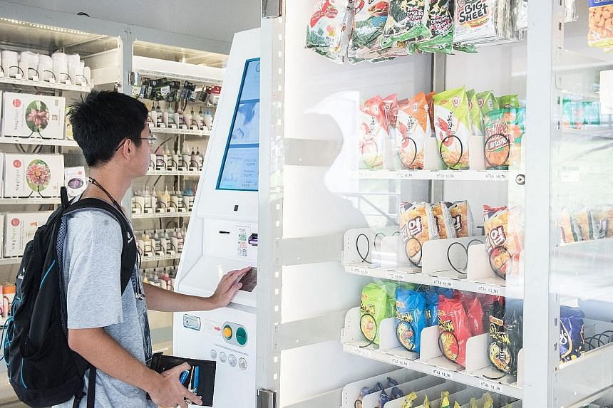 Mr Khairul buys from a Ma2shop machine at Block 143 Tampines Street 12 for the first time. Student Ian Soh, 17, says he buys from the vending machines in Ang Mo Kio Avenue 10 because they are convenient.