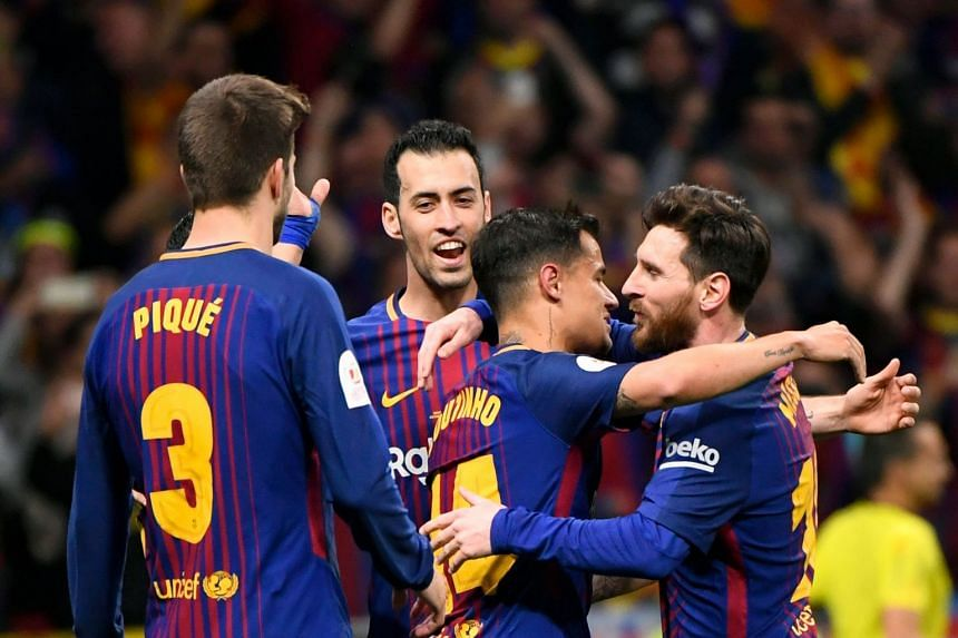 Barcelona's Brazilian midfielder Philippe Coutinho (centre) celebrates with team mates after scoring.