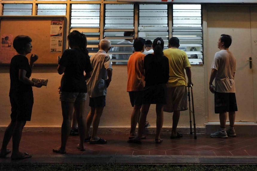 File photo showing people waiting outside a venue of a Meet-the-People Session in Tanjong Pagar.