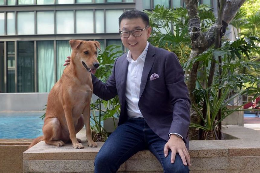 """Mr Steven Seow, who started Singapore Consultancy in 2016, with his dog Banana. He adopted the dog two years ago and considers it his best """"investment"""" as he gets so much joy from it, something that money can never buy."""
