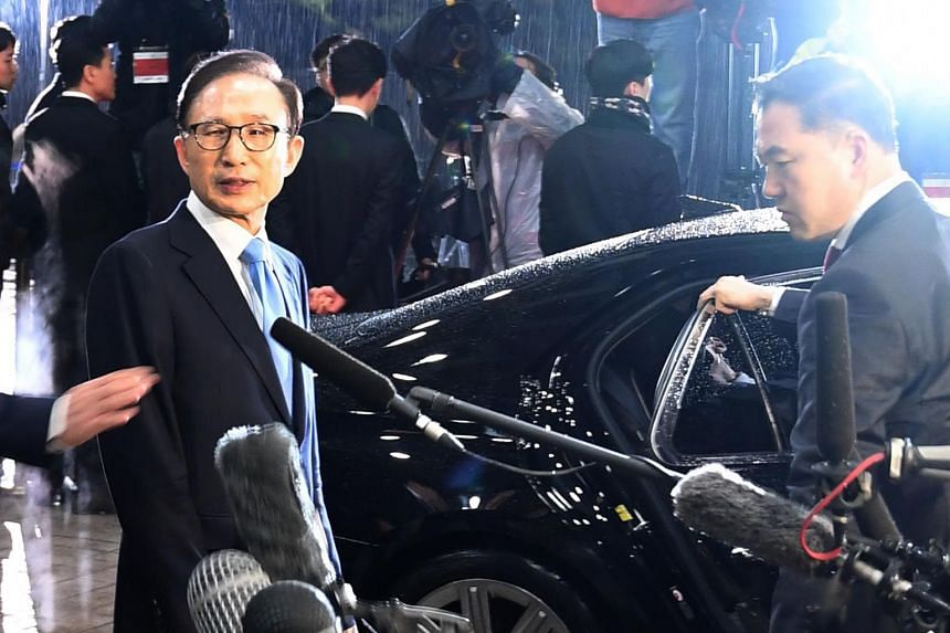 Lee Myung Bak, who served as president from 2008 to 2013, leaving the prosecutors' office in Seoul last month after an interrogation. He was indicted this month for bribery, embezzlement and other charges. Park Geun Hye, who served as president from