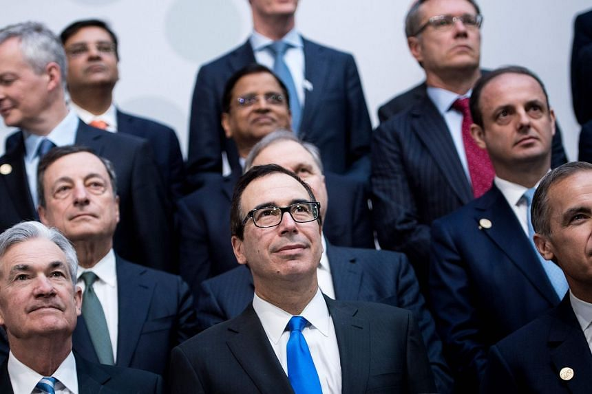 Mnuchin stands with others during a group photo of G-20 Finance Ministers and Central Bank Governors.