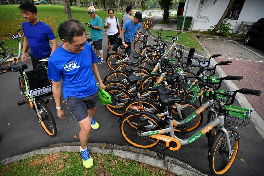 Mr James Heng, 51, an IT manager, choosing his bicycle at Punggol Park before the start of the Eat and ride programme.