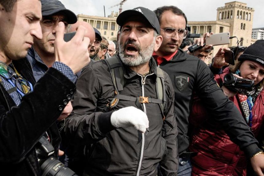 Armenian anti-government protest leader Nikol Pashinyan leaving a hotel after a televised meeting with Prime Minister Serzh Sarkisian was cancelled, in Yerevan on April 22, 2018.