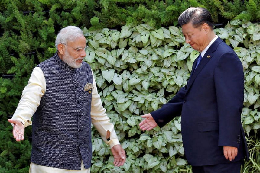 Indian Prime Minister Narendra Modi and Chinese President Xi Jinping leaving a Brics summit together in Goa, India on Oct 16, 2016. The two leaders will be meeting again in Wuhan, China, on April 27-28.