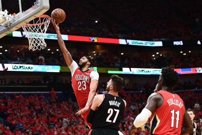 New Orleans Pelicans centre Anthony Davis (#23) going for a layup against Portland Trail Blazers centre Jusuf Nurkic during the NBA playoff match on April 21, 2018.