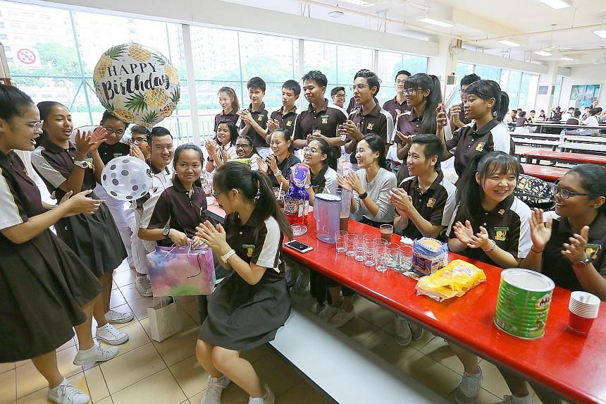 Dunman Secondary form teacher Wong Li Qin and her Secondary 4 students having a surprise birthday celebration for Nur Anisa Dzulraini (holding bag). Having breakfast together in the canteen every Friday has helped to forge closer ties between the stu