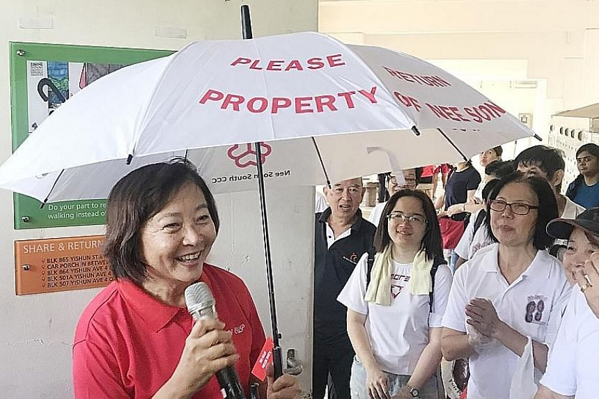 Nee Soon GRC MP Lee Bee Wah at the launch of the umbrella-sharing initiative, part of a series of activities to mark Earth Day, yesterday.