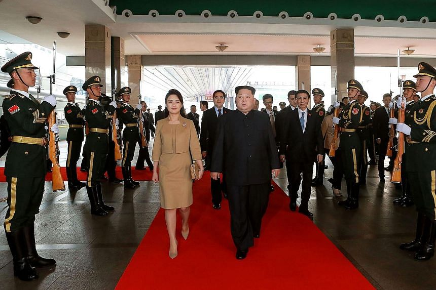 """North Korean leader Kim Jong Un arriving in Beijing with his wife Ri Sol Ju last month. Ms Ri's media exposure has risen since then, in what is seen as a move by Mr Kim to establish the two of them as a """"power couple""""."""