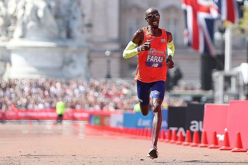 Britain's Mo Farah crossing the finish line of the London Marathon yesterday in a national record of 2hr 6min 21sec. After the race, he claimed some marathon staff had been more focused on taking pictures than helping runners.