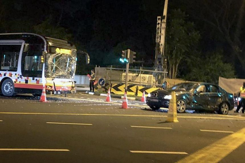 The SMRT bus and the Mercedes car after the accident, which took place at the junction of Jalan Anak Bukit and Jalan Jurong Kechil early yesterday morning.