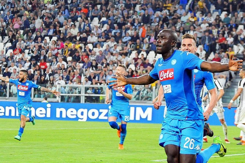 Napoli's Kalidou Koulibaly (front) celebrates after scoring at the Italian Serie A soccer match between Juventus FC and SSC Napoli in Turin, Italy, on April 22, 2018.