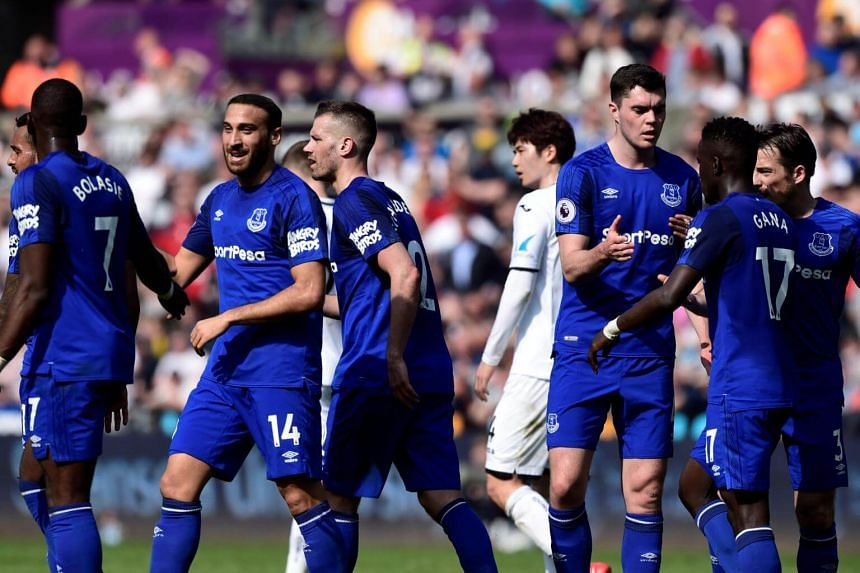 Everton players celebrates their first against Swansea City during their English Premier League match at Liberty Stadium, on April 14, 2018.