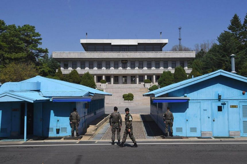 South Korean soldiers standing guard before the military demarcation line at the border truce village of Panmunjom in the Demilitarized Zone (DMZ) dividing the two Koreas, on April 11, 2018.