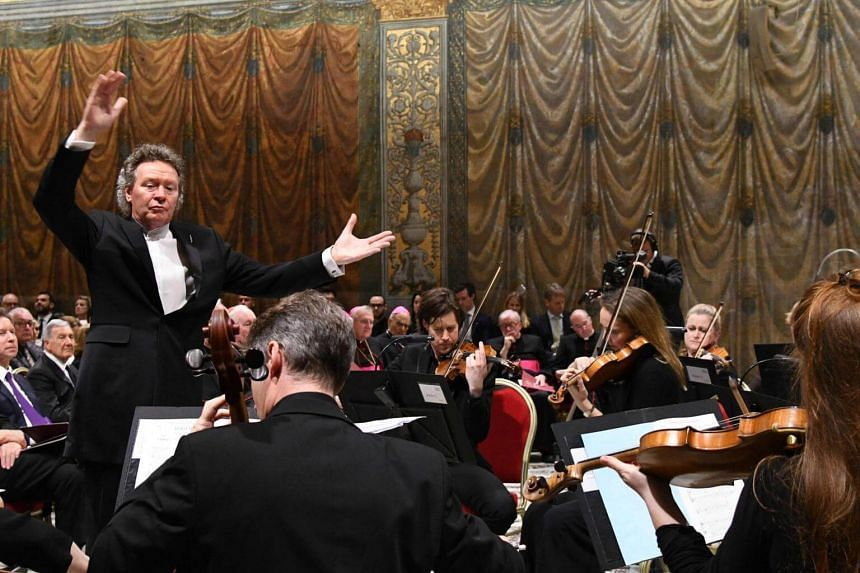 British composer Harry Christophers conducts the sir James MacMillian's Stabat Mater by British choir, in the Sistine Chapel at the Vatican, on April 22, 2018.