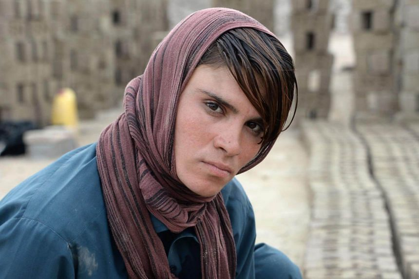 """With five sisters and no brothers, Sitara Wafadar lives by the gender-twisting custom known as """"bacha poshi"""", which in Dari refers to a girl """"dressed as a boy""""."""