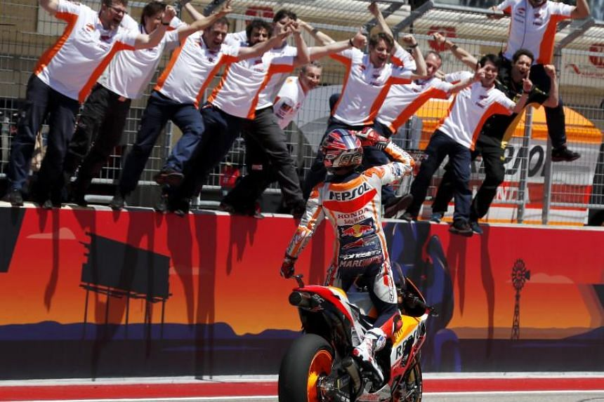 Repsol Honda Team rider Marc Marquez of Spain and his team celebrate Marquez' win at the MotoGP race at the Motorcycling Grand Prix of the Americas at Circuit of the Americas in Austin, Texas, US on April 22, 2018.