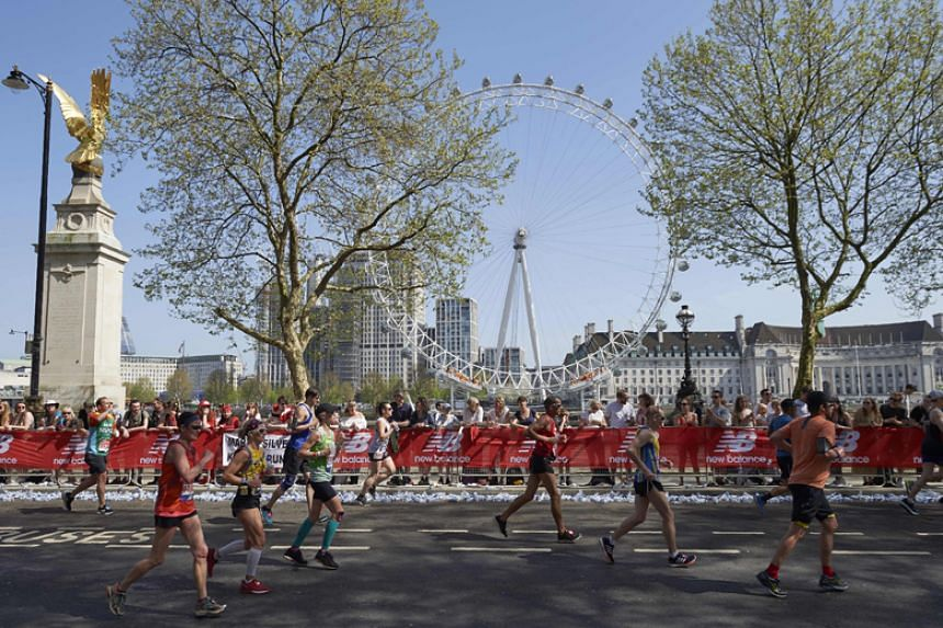Participants run in the 2018 London Marathon on April 22, 2018.