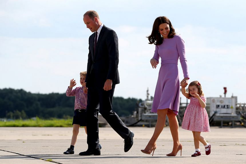 Britain's Prince William, his wife Kate, and his children Prince George and Princess Charlotte walking to board their plane at Hamburg Finkenwerder Airport, Germany, on July 21, 2017.