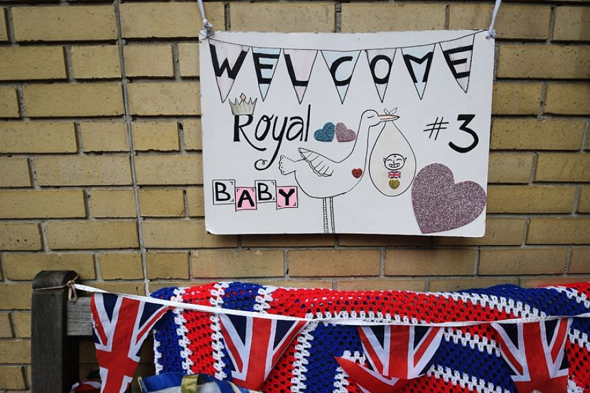 A sign hung by well-wishers outside the Lindo Wing of St Mary's hospital in London, where Duchess of Cambridge Kate Middleton gave birth, on April 23, 2018.