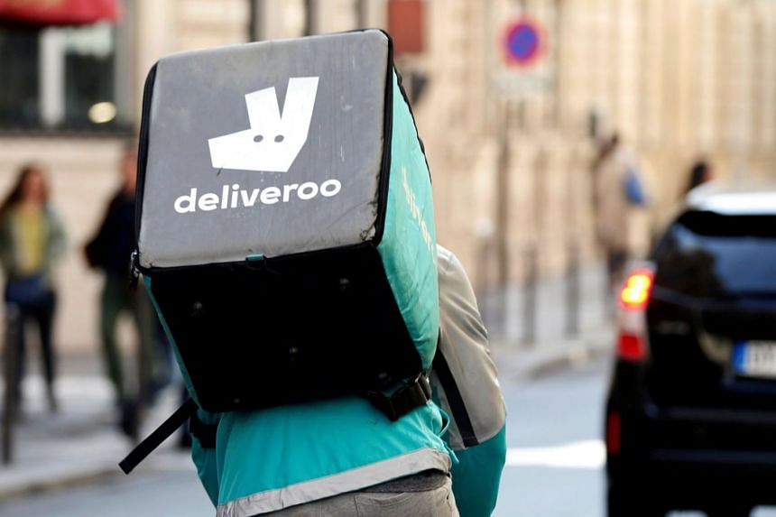 File photo showing a cyclist riding a bicyle as he delivers food for Deliveroo.