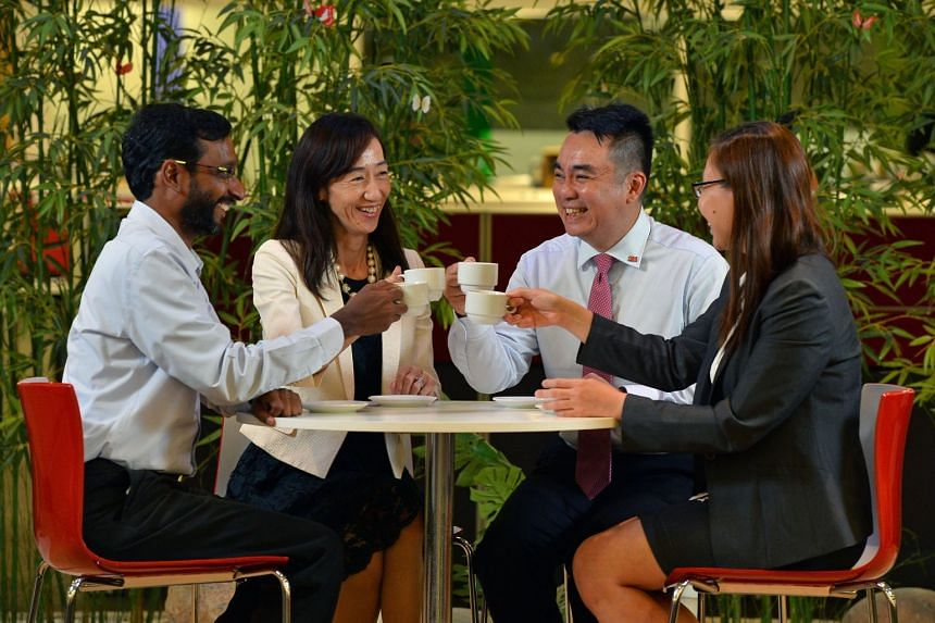 3M Singapore's multiracial credentials are reflected in the team of (from left) Mr Muralidharan Selvaraj, Ms Yuko Nakahira, Dr Audi Fong and Ms Justina Lee. Working with a diverse team enhances the