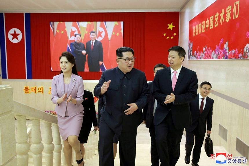 Ms Ri Sol Ju (left) accompanying North Korean leader Kim Jong Un (centre) as he meets Mr Song Tao, the head of the China's Communist Party's International Department who led a Chinese art troupe to North Korea for the April Spring Friendship Art Fest