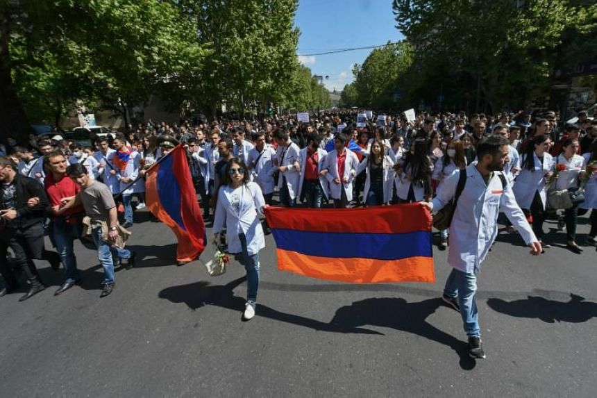 Armenian students marching through the streets of Yerevan on April 23, 2018, to protest against former president Serzh Sarkisian's election as prime minister.