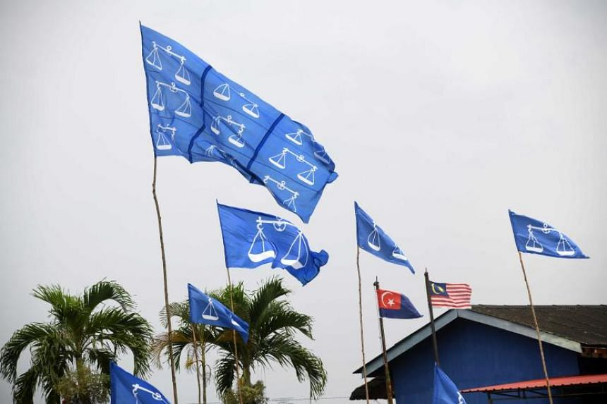 Flags of Malaysia's ruling Barisan Nasional fluttering on poles ahead of the 14th general elections in Johor, on April 23, 2018.