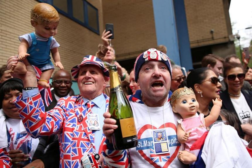 Royal fans celebrate the news that Britain's Duchess of Cambridge Kate Middleton gave birth to a baby boy outside the Lindo Wing at St. Mary's Hospital in London on April 23, 2018.