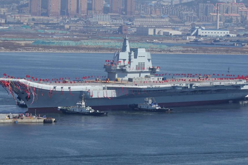 China's first domestically built aircraft carrier is seen during its launching ceremony in Dalian, Liaoning province, on April 26, 2017.
