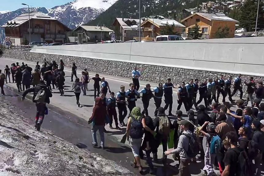 A screengrab of a video taken on April 22, 2018, shows demonstrators taking part in a protest walk at Montgenevre, on the border between France and Italy in the Alps, to help nearly 30 migrants cross the border to France.