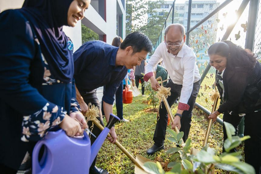 From left: Rahimah Jaffar, chairman of Juying Primary School's Parent Support Group, Lee Seng Hai, Superintendent of Schools, Cluster West 3, Yee Chia Hsing, MP for Chua Chu Kang GRC and Sroya Jaswant, Principal of Juying Primary School, planting fru