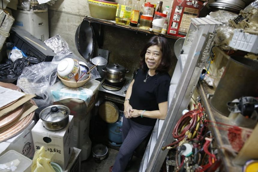 Ms Wong Siew Lin standing next to the kitchen area of her workshop at Geylang East Industrial Complex.