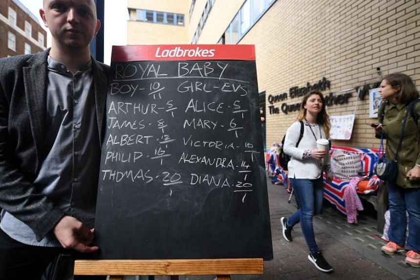 A Ladbrokes staff displaying a betting board outside the Lindo Wing of Saint Mary's hospital in London, Britain, on April 23, 2018.