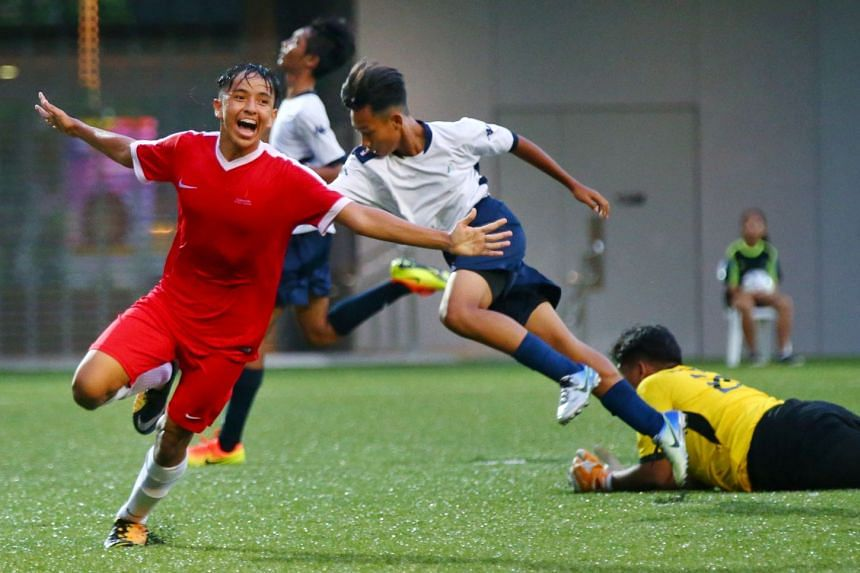 A joyous Singapore Sports School player Muhammad Fathullah Rahmat, who wheels away after scoring their second goal against Meridian Secondary in the 2-0 win in the B Division Football Schools Premier League 1 final.