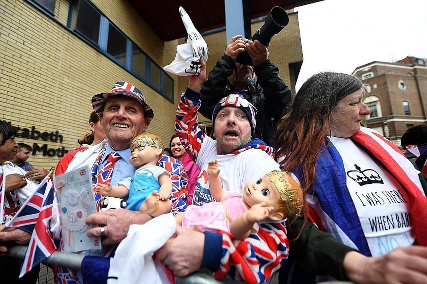 Royal well-wishers outside St Mary's Hospital in London yesterday where the new prince was born.