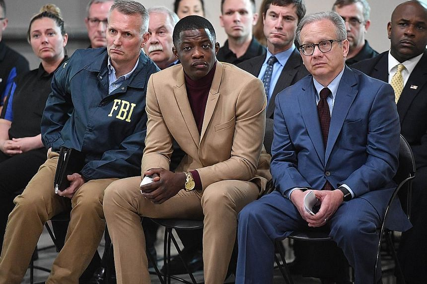 Mr James Shaw (in brown suit), who has been credited with saving the lives of customers at the waffle restaurant, at a press conference on Sunday with Metro Nashville Mayor David Briley (right)