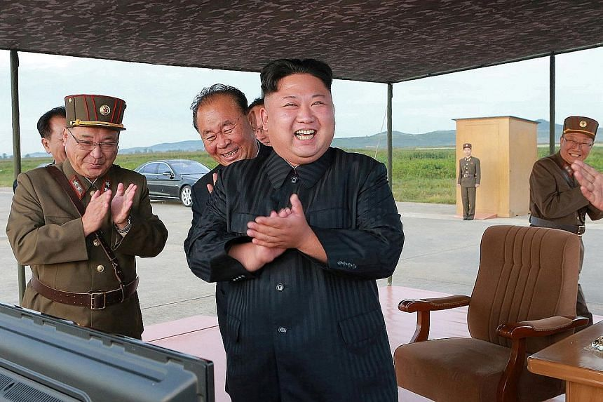 North Korean leader Kim Jong Un at the launch of a Hwasong-12 missile in an undated photo released by North Korea's Korean Central News Agency last September.