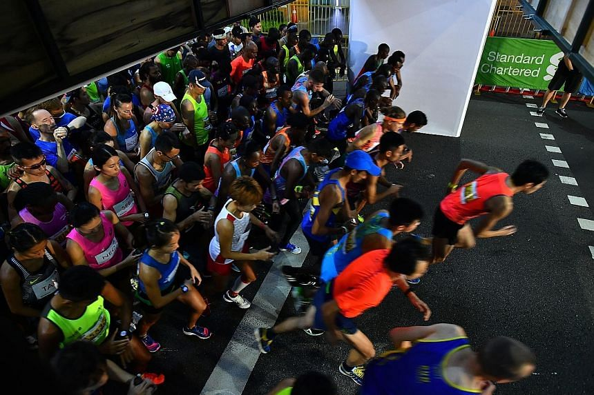 Runners being flagged off for the Standard Chartered Singapore Marathon 2017 in the early hours of Dec 3 in Orchard Road. After a marathon, runners should take time off for torn muscle fibres to heal. If you crave being active, go for a swim, or do a