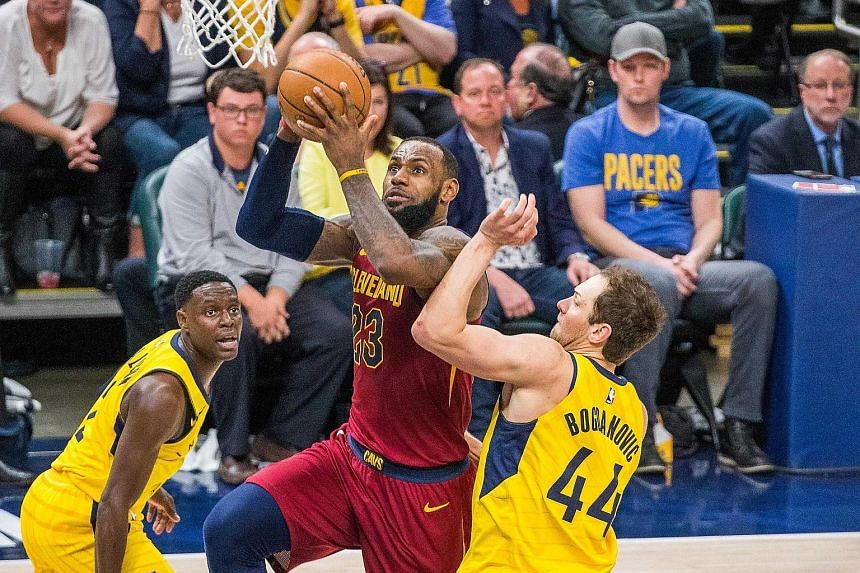Cleveland Cavaliers forward LeBron James shooting the ball while Indiana Pacers guard Darren Collison and forward Bojan Bogdanovic defend in the second half of their Eastern Conference first-round play-off series. The Cavaliers won Game 4 104-100 to