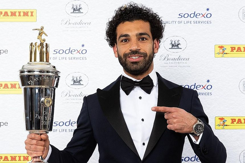 Mohamed Salah posing with the PFA Player of the Year trophy. The Egyptian pipped Manchester City's Kevin de Bruyne to the award.