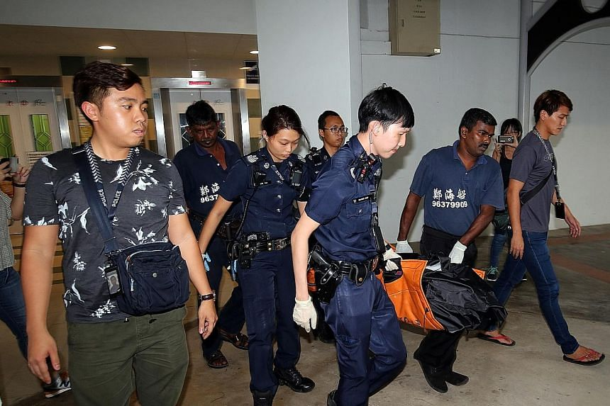 Police officers and undertakers removing the body of 77-year-old Madam Tay Quee Lang on Feb 13 last year. Her Indonesian maid, Minah, pleaded guilty to a charge of culpable homicide for killing the elderly woman.