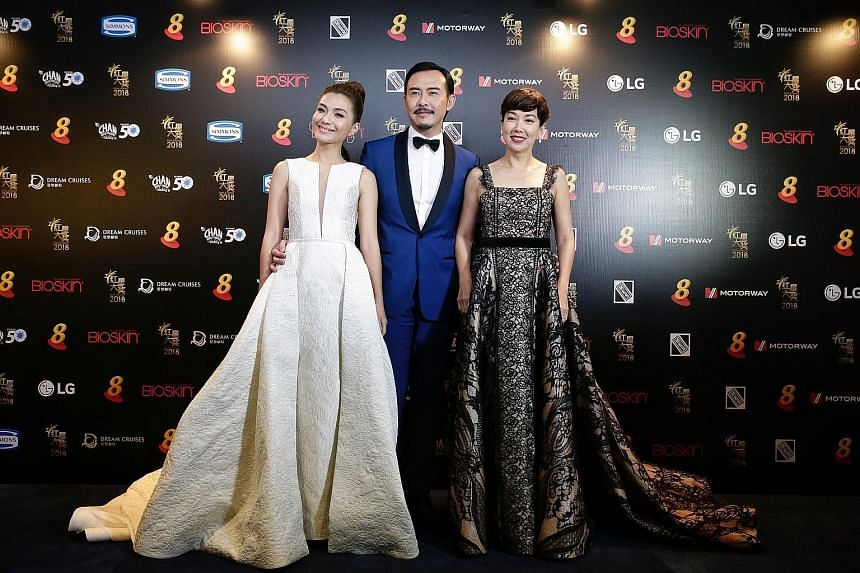 (From left) Vivian Lai, Bryan Wong and Kym Ng, who won her first acting award for Best Supporting Actress for her mother role in When Duty Calls.