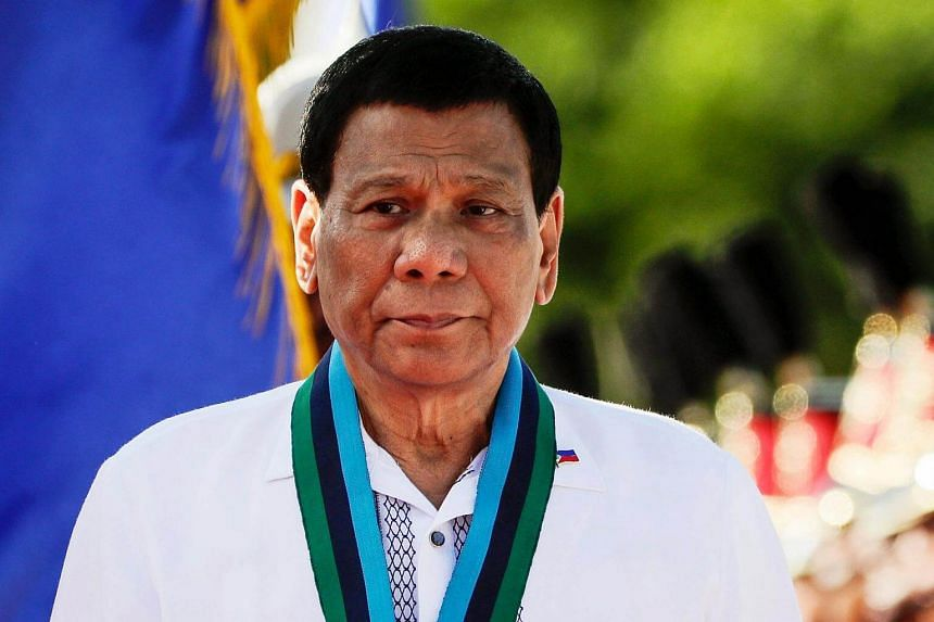 Philippine President Rodrigo Duterte looks on during the Armed Forces of the Philippines change of command ceremony at a military camp in Quezon City on April 18, 2018.