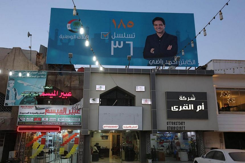 Campaign poster of Ahmed Radhi, a former Iraqi footballer, hanging in a street in Baghdad, on April 23, 2018.