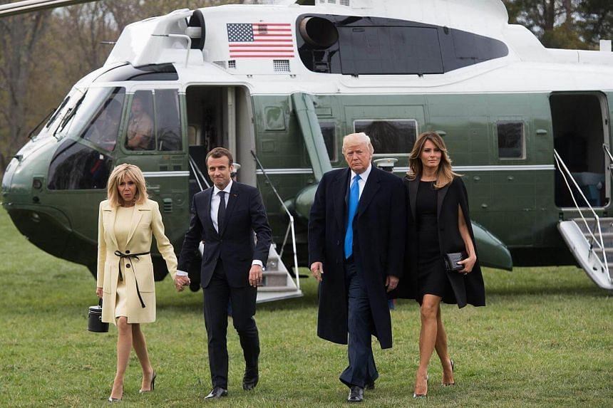 US President Donald Trump and First Lady Melania Trump (right) walking with and French President Emmanuel Macron and his wife, Brigitte, before the State Dinner at the White House.