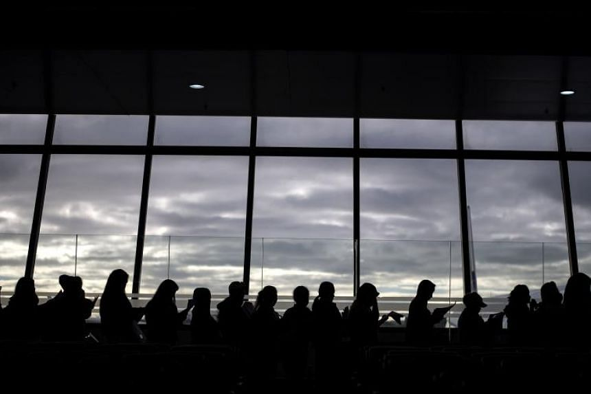 Filipina workers returning home from Kuwait arrive at Manila International Airport on Feb 18, 2018.