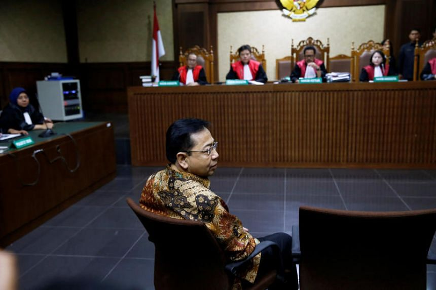 Former Indoensian parliament speaker Setya Novanto sits before his trial at a court room in Jakarta on April 24, 2018.